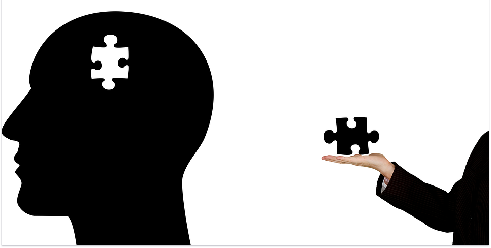 An illustrated human head with a missing puzzle to be added.